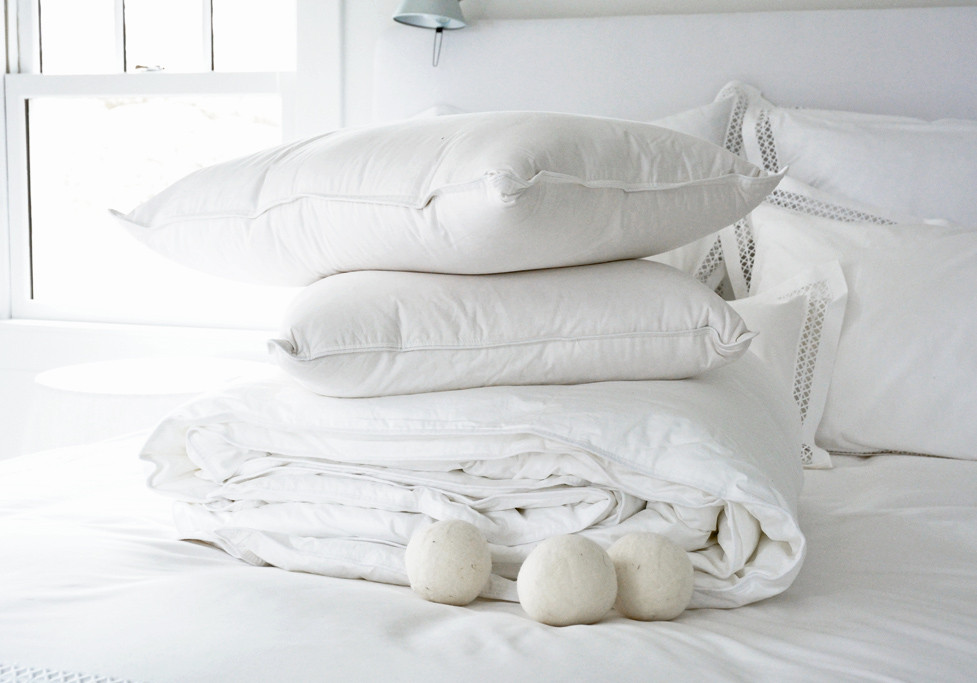 how to wash down bedding: comforters & pillows | the laundress