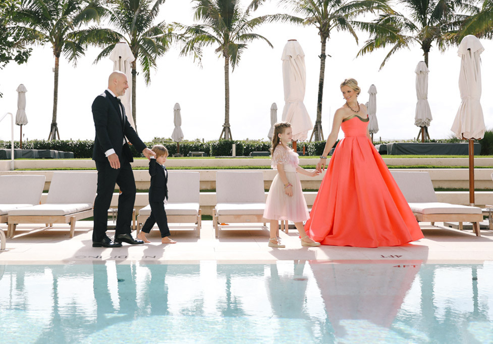 family walking by pool