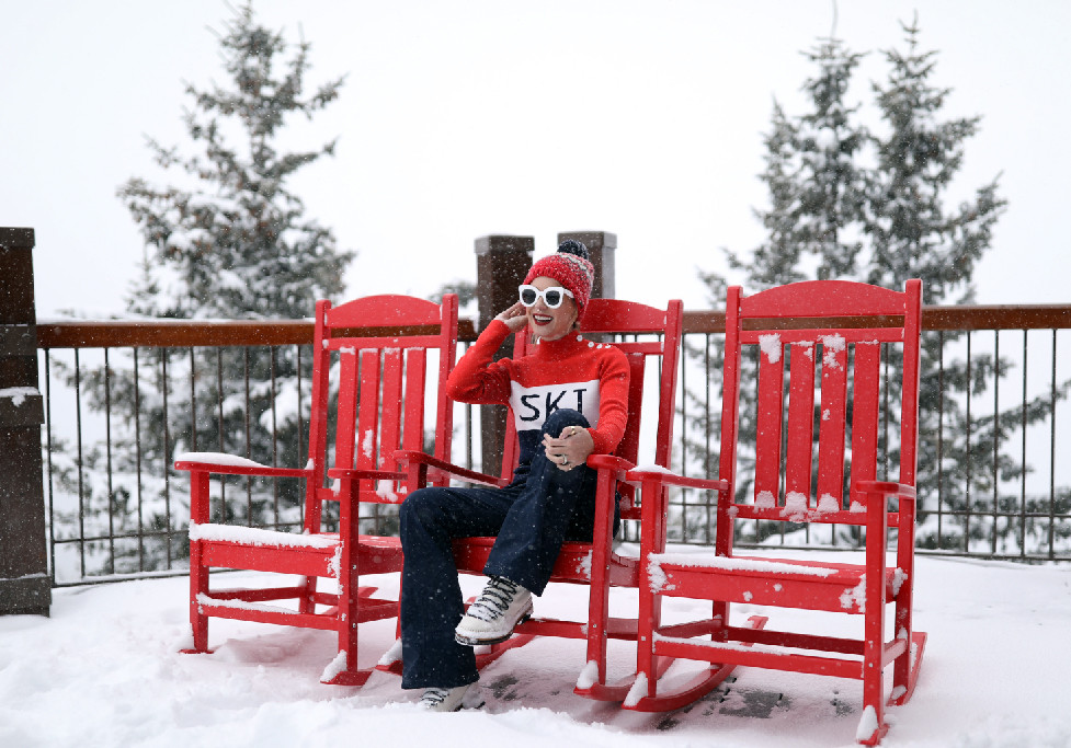 woman sitting on a chair outside in a wintery environment
