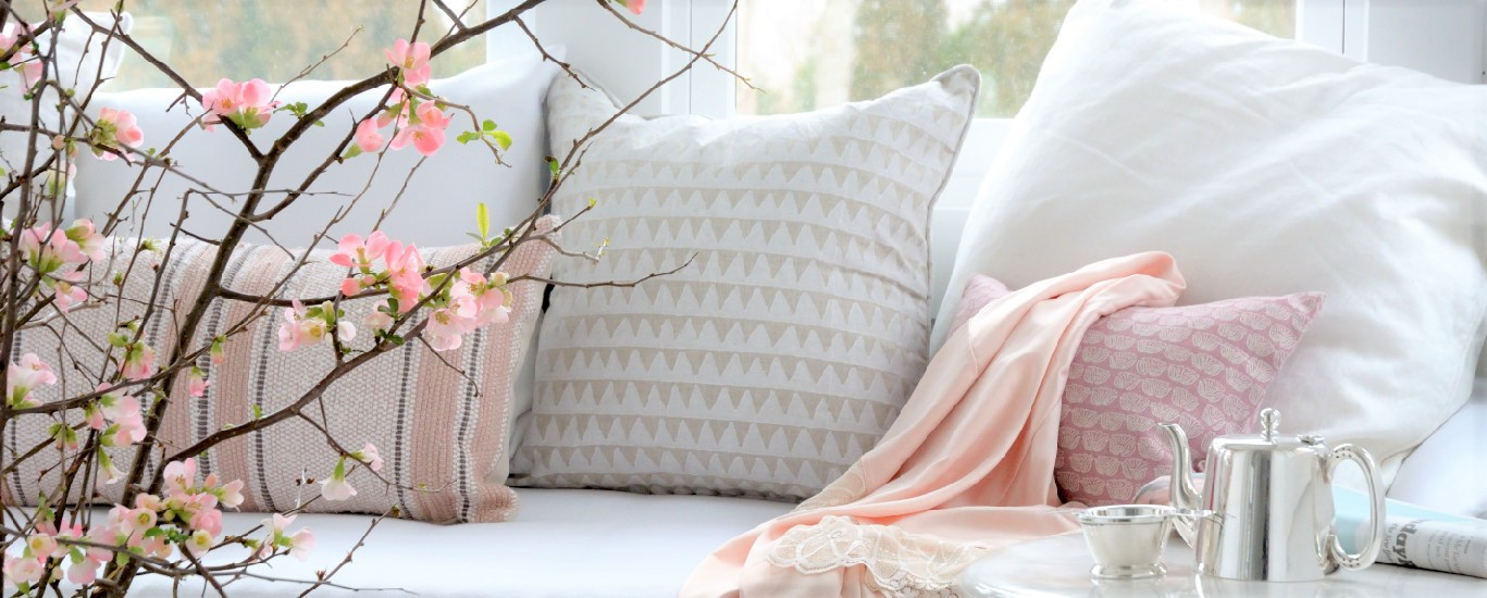 couch with pink accents