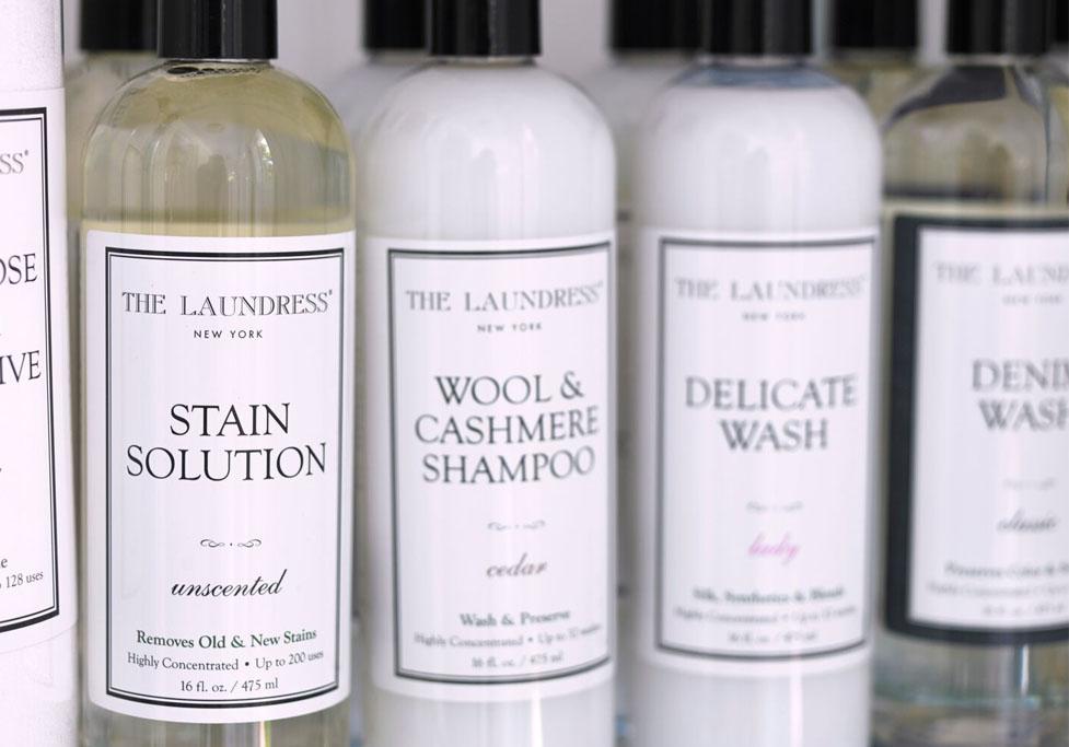 the laundress bottles on a shelf