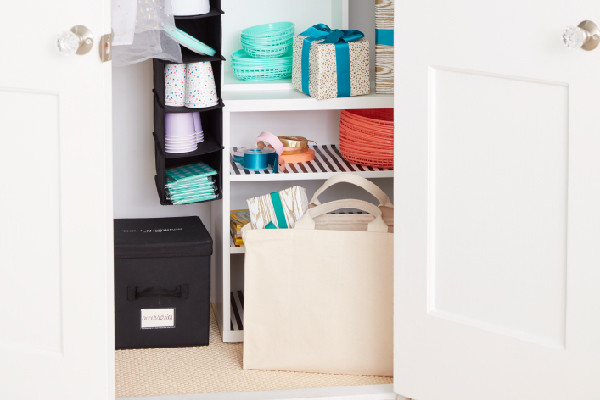 party supplies in hanging organizers and boxes