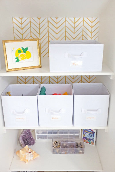 white storage boxes on shelf
