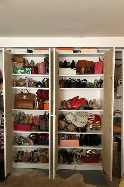 closet full of shoes and bags