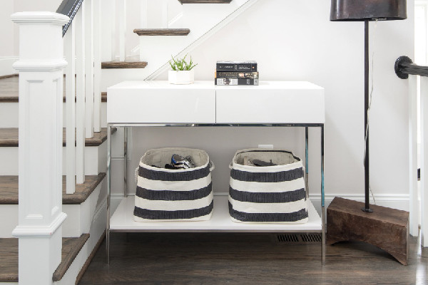 entryway with stairs and a table with extra storage