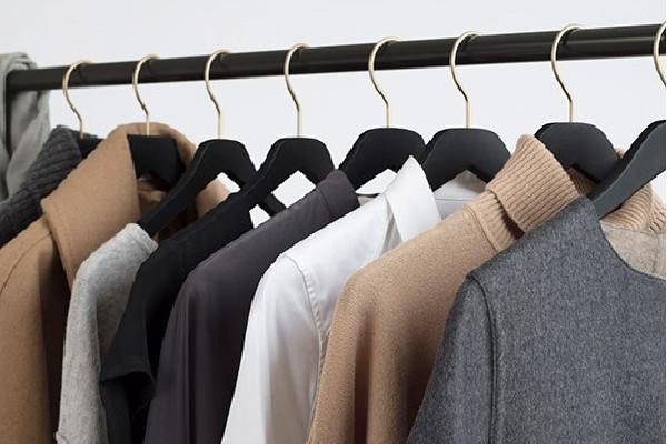 few Cuyana clothes on a garment rack