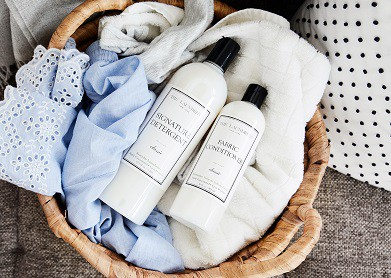 2 laundress products in a basket of clothes
